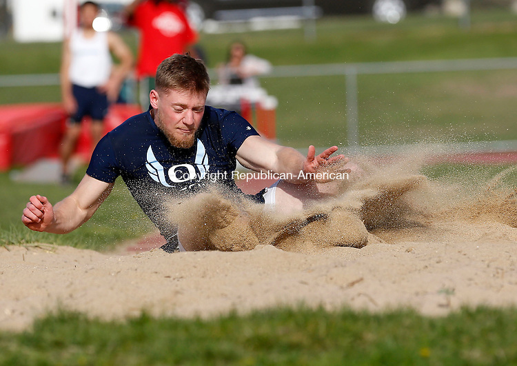 Walcott, CT- 05 May 2015-050515CM09-  Oxford's Vinny Loomis lands a long jump during a multi-team track meet at Wolcott on Tuesday afternoon.   Christopher Massa Republican-American