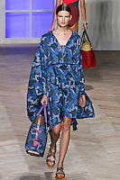 Bette Franke walks the runway in a blue camouflage nylon hooded poncho, blue camouflage bikini top, and blue camouflage bikini bottom with orange belt, by Tommy Hilfiger for the Tommy Hilfiger Spring 2012 Pop Prep Collection, during Mercedes-Benz Fashion Week Spring 2012.