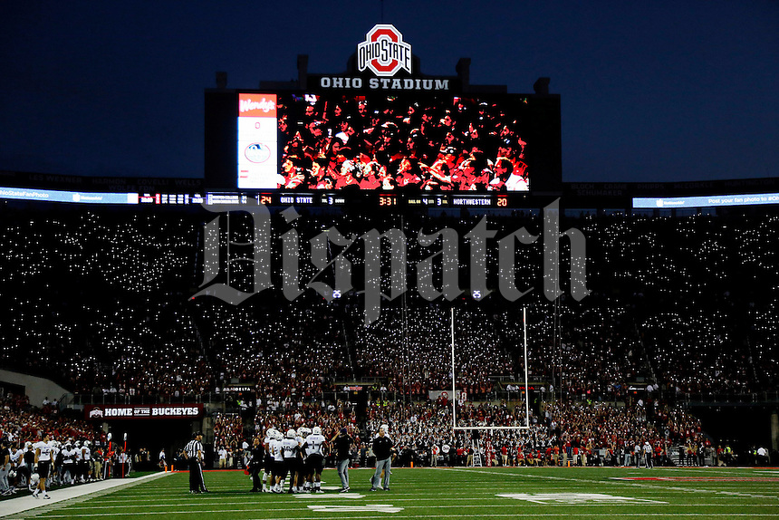 Ohio State Buckeyes student section in the south stands use their cell phones during an O-H-I-O chant during the 2nd half of their game at Ohio Stadium in Columbus, Ohio on October 29, 2016.  (Kyle Robertson / The Columbus Dispatch)