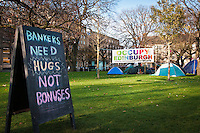 "A ""Bankers Need Hugs, not Bonuses"" sign at the Occupy Edinburgh camp, St Andrew's Square, Edinburgh, Scotland"