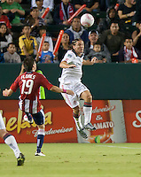 CARSON, CA – OCTOBER 9: Chivas USA midfielder Jorge Flores (19) and Toronto FC defender Maksim Usanov (33) during a soccer match at Home Depot Center, October 9, 2010 in Carson California. Final score Chivas USA 3, Toronto FC 0.