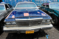 An American classic cars from 1970s, used as a shared taxi, seen parked in front of the wall in Maracaibo, Venezuela, 10 May 2006.