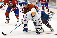 TORONTO, ON: September 27, 2005 -- AHL HOCKEY: TORONTO MARLIES VS. HAMILTON BULLDOGS. -- Toronto Marlies forward Kris Newbury (R) keeps his eye on the puck despite being tripped up by Hamilton Bulldogs' forward Maxim Lapierre during AHL exhibition action against the Hamilton Bulldogs in Oshawa September 27.&amp;#xD;<br />