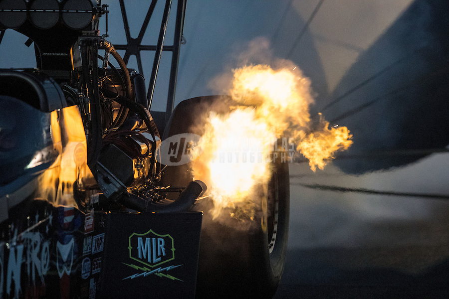 Nov 11, 2016; Pomona, CA, USA; Flames come from the exhaust header pipes from the engine on the dragster of NHRA top fuel driver Tripp Tatum during qualifying for the Auto Club Finals at Auto Club Raceway at Pomona. Mandatory Credit: Mark J. Rebilas-USA TODAY Sports