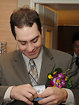 Taiwanese Wedding -- The groom putting on his tie clip and getting ready to pick up the bride at her parents house.