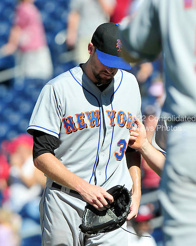 New York Mets pitcher Bobby Parnell (39) leaves the field after giving up the winning rub to the Washington Nationals at Nationals Park in Washington, D.C. on Sunday, July 31, 2011.  The Nationals won the game 3 - 2..Credit: Ron Sachs / CNP.(RESTRICTION: NO New York or New Jersey Newspapers or newspapers within a 75 mile radius of New York City)