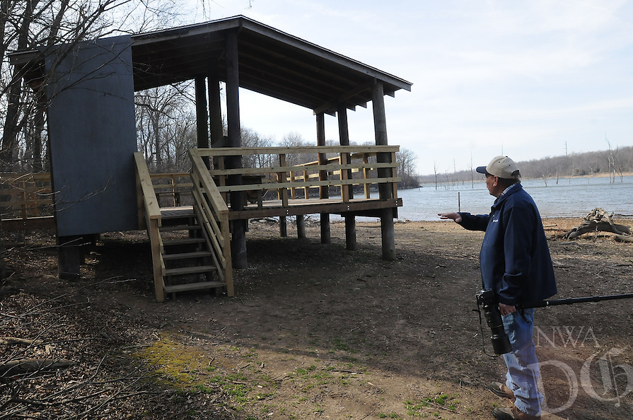 NWA Democrat-Gazette/FLIP PUTTHOFF <br /> Stanfill shows Feb. 10 2017 improvements to the original wildlife viewing pavilion near Swepco Lake at the end of the trail.