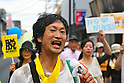 Tokyo, Japan - June 17: A man yelled through a microphone against nuclear power plants in Japan during a demonstration at Mitaka, Tokyo, Japan on June 17, 2012. As Japanese Government decided to restart Oi Nuclear Power Plants No.3 and 4 in Fukui, people spoke up against the restart throughout the nation. .