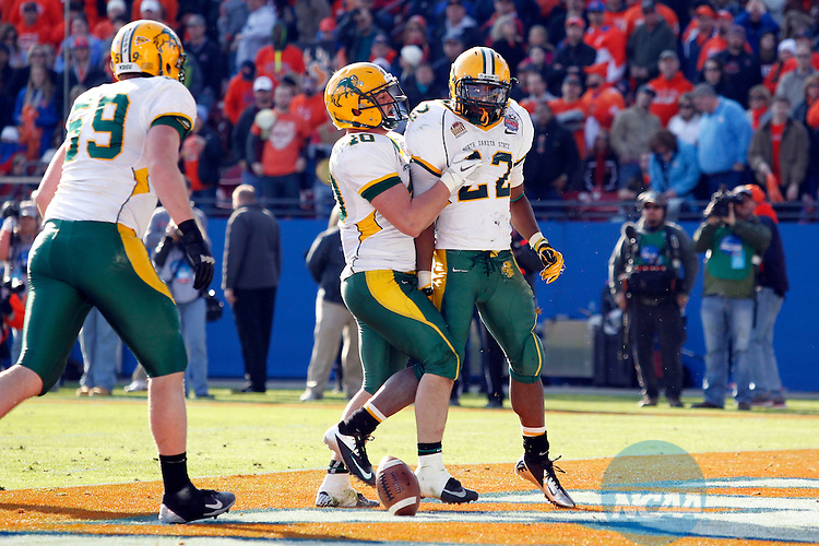 05 JAN 2013: Andrew Grothmann (40) of the North Dakota State Bison celebrates with teammate Sam Ojuri (22) after Ojuri's third quarter touchdown during the Division I Men's Football Championship held at FC Dallas Stadium in Frisco, TX.  North Dakota State defeated Sam Houston State 39-13 for the national championship. Ron Jenkins/NCAA Photos