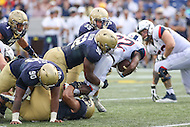 Annapolis, MD - September 9, 2016: Navy Midshipmen defensive end Amos Mason (52) tackles Connecticut Huskies running back Arkeel Newsome (22) during game between UConn and Navy at  Navy-Marine Corps Memorial Stadium in Annapolis, MD. September 9, 2016.  (Photo by Elliott Brown/Media Images International)