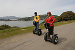 Couple on Segways, each on a Segway, on Angel Island State Park in San Francisco Bay, California, CA. Model released..Photo camari212-70538..Photo copyright Lee Foster, www.fostertravel.com, 510-549-2202, lee@fostertravel.com.