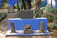 Pre-Columbian artifacts and outdoor cafe at the Museo Frida Kahlo, also known as the Casa Azul, or Blue house, Coyoacan, Mexico City