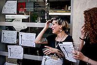 Roma, 9 Giugno  2015<br /> Il comune di Roma revoca la concessione del Nuovo Cinema Aquila, storico cinema del quartiere Pigneto, con tre anni di anticipo rispetto alla scadenza del regolare contratto di concessione e i lavoratori del cinema verranno licenziati.<br /> Il Nuovo Cinema Aquila &egrave; l'unico cinema che a Roma  a proiettato il film di Sabina Guzzanti &quot;La trattativa Stato-Mafia&quot;.  Nella foto:  Una ragazza piange per la chiusura del cinema.<br /> Rome, June 9, 2015<br /> The municipality of Rome revoked the grant of the Nuovo Cinema Aquila, the historic movie theater of Pigneto, with three years in advance of the expiry of the concession contract and regular employees of the cinema will be laid off.<br /> The Nuovo Cinema Aquila is the only cinema in Rome to screen the film by Sabina Guzzanti &quot;Negotiation State-Mafia&quot;. Pictured : A girl cries for closing of the  movie theater<br /> The Nuovo Cinema Aquila is the only cinema in Rome to screen the film by Sabina Guzzanti &quot;Negotiation State-Mafia&quot;.