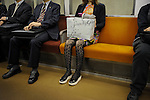 _SAM4914, British Airways, Tokyo, Japan, 10/2008, JAPAN-10136. A woman sits on the subway.