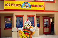 """A pop-up of the renowned Los Polos Hermanos chicken fast food restaurant appears in a parking lot in Lower Manhattan in New York on Sunday, April 9, 2017. The fictional restaurant is part of the plot of """"Better Call Saul"""" (and its parent program """"Breaking Bad"""") on the AMC network. Serving free curly fries to its fans who waited several hours to get in, the two-day branding event's last day is Monday, April 10, 2017. """"Better Call Saul"""" debuts its new season on April 10. (© Richard B. Levine)"""
