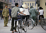 A policeman directs rush hour traffic in Hanoi, North Vietnam.  (Jim Bryant Photo).....