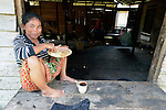 A woman eats a meal in the village of Moawo on the Indonesian island of Nias. Following the devastating 2004 tsunami and 2005 earthquake on Nias, YEU, a member of the ACT Alliance, built 72 houses in the community. With foundations of cement, they are more resilient than the pre-tsunami houses which were built entirely of wood. YEU also helped the community members restart their local economy, and assisted the community as it planted mangroves to protect the shoreline and revitalize their fishing industry.