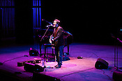 September 7, 2012. Raleigh, North Carolina.. John Darnielle of the Mountain Goats takes the stage at Fletcher Opera Hall for the second of his 2 sets at the venue..Hopscotch 2012, Day Two.