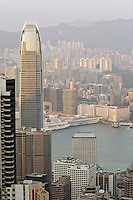 Hong Kong's Central and Tsim Sha Tsui districts, either side of the harbour, seen from Victoria Peak in late afternoon sun. Even here, the top of the IFC2 tower is higher than the vantage point