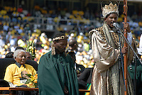 Nelson Mandela listens as a religeous leader speaks at an African National Congress (ANC) election rally held at the Ellis Park Stadium in Johannesburg..