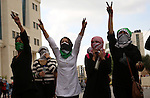 Palestinian girls flashe victory sign during clashes with Israeli security forces in Beit El on the outskirts of the West Bank city of Ramallah, on October 10, 2015. Fifteen Palestinians have been killed by Israeli forces and around 1,000 injured with live and rubber-coated steel bullets in the occupied West Bank and Gaza Strip since Oct. 1. Photo by Shadi Hatem