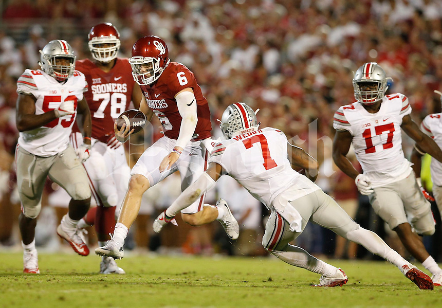 Oklahoma Sooners quarterback Baker Mayfield (6) is pursued by Ohio State Buckeyes cornerback Damon Webb (7) during Saturday's NCCAA Division I football game between the Ohio State Buckeyes and the Oklahoma Sooners at Gaylord Family - Oklahoma Memorial Stadium in Norman, Ok., on September 17, 2016. (Barbara J. Perenic/The Columbus Dispatch)