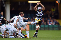 Will Chudley of Exeter Chiefs box-kicks the ball as Dave Attwood of Bath Rugby looks to charge him down. West Country Challenge Cup match, between Bath Rugby and Exeter Chiefs on October 10, 2015 at the Recreation Ground in Bath, England. Photo by: Patrick Khachfe / Onside Images