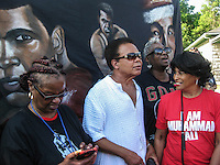 LOUISVILLE, KY - JUNE 10: People gather on Grand Avenue in front of Muhammad Ali's childhood home waiting for the funeral procession motorcade for Ali on June 10, 2016 in Louisville, Kentucky. (Photo by VIEWpress/Teddy Blackburn)