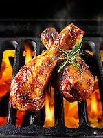 BBQ chicken thighs cooking on a bbq. Food photos, pictures & images.