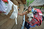 Jovita Guzman collects her clothes from a clothesline at her home in Comitancillo, Guatemala.