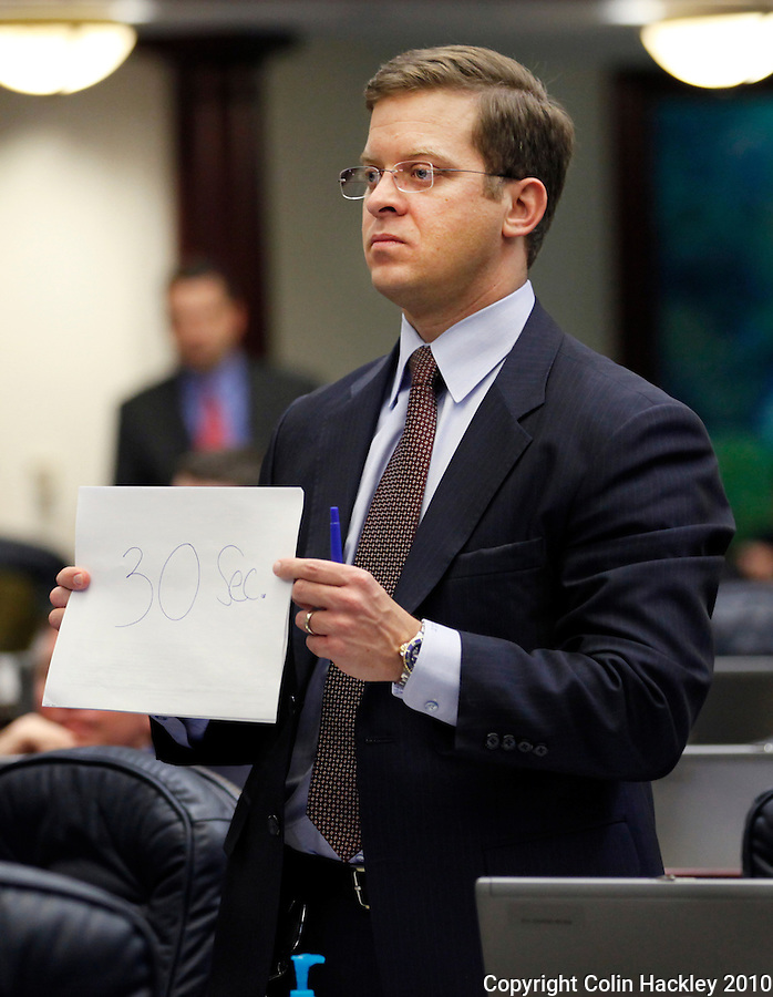 TALLAHASSEE, FLA. 4/30/10-SESSIONEND 43010 CH17-Rep. Carlos Lopez-Cantera, R-Miami, holds a sign up warning Rep. David Rivera, R-Miami, that his time is nearly up on debate of the budget Friday at the Capitol in Tallahassee...COLIN HACKLEY PHOTO