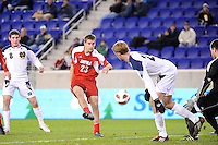 J.T. Murray (23) of the Louisville Cardinals shoots and scores the game's only goal. The Louisville Cardinals defeated the Notre Dame Fighting Irish 1-0 during the semi-finals of the Big East Men's Soccer Championship at Red Bull Arena in Harrison, NJ, on November 12, 2010.