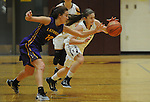 Ketchikan's AJ Dela Cruz steals the ball from Lathrop's Cheyenne Dibert in their Dimond Lady Lynx Prep Shootout basketball game Friday, February 10, 2017.  Photo for the Daily News by Michael Dinneen