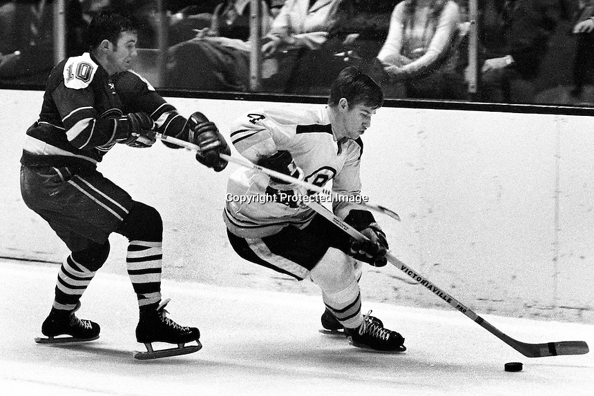 California Golden Seal Ted hampson chasing Boston Bruin Bobby Orr. (1970 photo by Ron Riesterer)