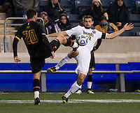 Andrew O'Malley (12) of Notre Dame fights for the ball with Jake Pace (20) of Maryland during the NCAA Men's College Cup final at PPL Park in Chester, PA.  Notre Dame defeated Maryland, 2-1.