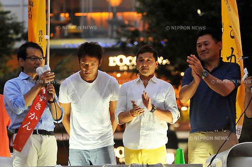 July 19th, 2013 : Tokyo, Japan - Hiroshi Mikitani, the founder and CEO of Rakuten, an electronic commerce and Internet company, right, Daisuke Nakano, a gymnastics gold medalist at the 2004 Athens Olympics, second from right, and Koichi Nishimura, a beach volleyball player, second from left, gathered and talked to people in support of Kan Suzuki, a member of House of Councilors from the Democratic Party of Japan, or DPJ, left, for the coming election that Suzuki was tanning this Sunday at Shibuya Station, Shibuya, Tokyo, Japan on July 19, 2013. Suzuki was a former senior vice minister of Education, Culture, Sports, Science and Technology and ran in Tokyo electoral district. (Photo by Koichiro Suzuki/AFLO)
