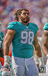 14 September 2014: Miami Dolphins defensive tackle Jared Odrick stands on the sidelines during a game against the Buffalo Bills at Ralph Wilson Stadium in Orchard Park, NY. The Bills defeated the Dolphins 29-10 to win their home opener and start the season with a 2-0 record. Mandatory Credit: Ed Wolfstein Photo *** RAW (NEF) Image File Available ***