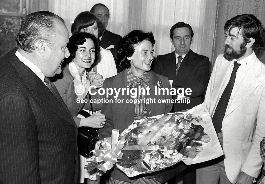New Zealand Prime Minister Robert Muldoon, accompanied by his wife Thea Muldoon, centre with bouquet, visited the Peace People in Belfast during a two day visit to N Ireland.  Also in the photo are Mairead Corrigan and behind her Betty Williams, partially hidden, founders of the Peace People, as is Ciaran McKeown (with beard), former Belfast journalist who was an early activist. 197706190207b.<br /> <br /> Copyright Image from Victor Patterson, 54 Dorchester Park, Belfast, UK, BT9 6RJ<br /> <br /> t: +44 28 90661296<br /> m: +44 7802 353836<br /> vm: +44 20 88167153<br /> e1: victorpatterson@me.com<br /> e2: victorpatterson@gmail.com<br /> <br /> For my Terms and Conditions of Use go to www.victorpatterson.com
