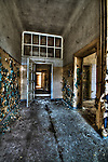 Abandoned lunatic asylum north of Berlin, Germany. Derelict corridor with peeling paint