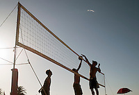 Local men playing volleyball on the beach in Swakopmund, Namibia