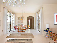 The house floorplan is a H shape and the dining area is situated in the link between the two sides, one incorporating the open-plan living space and the other the bedrooms and bathrooms
