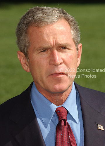 """Washington, DC - September 16, 2001 -- United States President George W. Bush returns from a week-end at Camp David on Sunday, September 16, 2001.  In remarks to the press as walked to the White House,  President Bush warned """"We need to be alert to the fact that these evil-doers still exist""""  and urged Americans to not let terrorism distract them from their normal routines..Credit: Ron Sachs / CNP"""