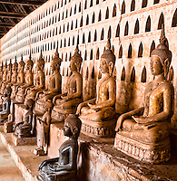 Each pigeon hole in this cloister contains two tiny Buddhas, with over two thousand Buddha images in this temple.<br /> (Photo by Matt Considine - Images of Asia Collection)
