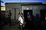 SOWETO, SOUTH AFRICA : Youths in a brass band rehearse in a backyard in Orlando, Soweto, South Africa. The band has about thirty members and they rehearse a few times a week and usually perform in churches, weddings and funerals during the weekends in the township. Soweto is South Africa's largest township and it was founded about one hundred years to make housing available for black people south west of downtown Johannesburg. The estimated population is between 2-3 million. Many key events during the Apartheid struggle unfolded here, and the most known is the student uprisings in June 1976, where thousands of students took to the streets to protest after being forced to study the Afrikaans language at school. Soweto today is a mix of old housing and newly constructed townhouses. A new hungry black middle-class is growing steadily. Many residents work in Johannesburg, but the last years many shopping malls have been built, and people are starting to spend their money in Soweto. (Photo by Per-Anders Pettersson)