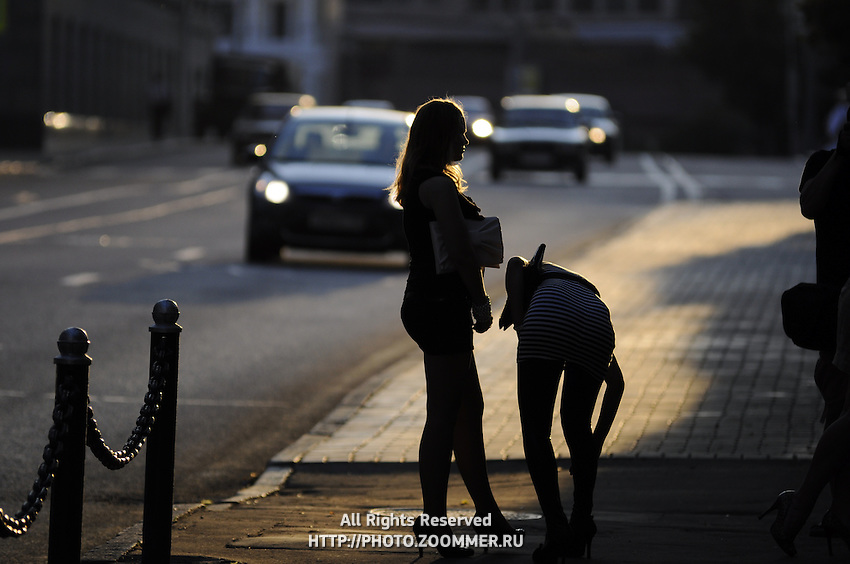 Girls by the side of street, silhouette