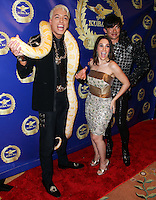 BEVERLY HILLS, CA, USA - MARCH 28: KUBA Ka, Christina DeRosa, Bobby Trendy at the Versace Unveiling Of The 1st Pop Recording Artist Superhero - KUBA Ka's Performance Outfits. Designed by the legendary fashion hosuse - Donatella Versace. For the Benefit of the Face Forward Foundation (Plastic Surgery for Destroyed Faces from Violence). Pop entertainer TV personality KUBA Ka, together with VERSACE, unveiled Kuba Ka's new Versace images, for the First Pop Artist/Superhero of the World. He has become the inspiration of Donatella's newest and wildest creations and will celebrate the launch of his new power house conglomerate - KUBA Ka Empire Inc. in collaboration with the sensational fashion house - VERSACE on Friday, his birthday at a red carpet media and celebrity event at the luxurious Peninsula Hotel in Beverly Hills held at the Peninsula Hotel on March 28, 2014 in Beverly Hills, California, United States. (Photo by Xavier Collin/Celebrity Monitor)
