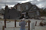 New Jersey, United States. 25th Feb, 2013 -- A man takes pictures of buildings destroyed almost 4 months ago by Sandy Storm at Jersey Shore in New Jersey. Photo by Kena Betancur / VIEWpress.