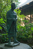 "A statue of Matsuo Basho at Chusonji temple, Hiraizumi, Japan, 28 August 2008. The poet visited Hiraizumi during the writing of the Narrow Road to the Deep North. Hiraizumi in Northern Japan flourished as the seat of the Oshu Fujiwara clan for around 100 years from the end of the 12th century. The city was built to be an earthly recreation of the Buddhist ""Pure Land"" or Nirvana."