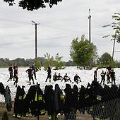 DOBRZYKOW, POLAND, MAY 24, 2010:.Rescue workers on the anti flood wall..The latest chapter of disastrous floods in Poland has been opened yesterday, May 23, 2010, after Vistula river broke its banks and flooded over 25 villages causing evacualtion of most inhabitants..Photo by Piotr Malecki / Napo Images..DOBRZYKOW, POLSKA, 24/05/2010:.Strazacy na scianie z piasku.  Najnowszy akt straszliwych tegorocznych powodzi zostal rozpoczety wczoraj gdy Wisla przerwala waly na wysokosci wsi Swiniary kolo Plocka..Fot: Piotr Malecki / Napo Images ..