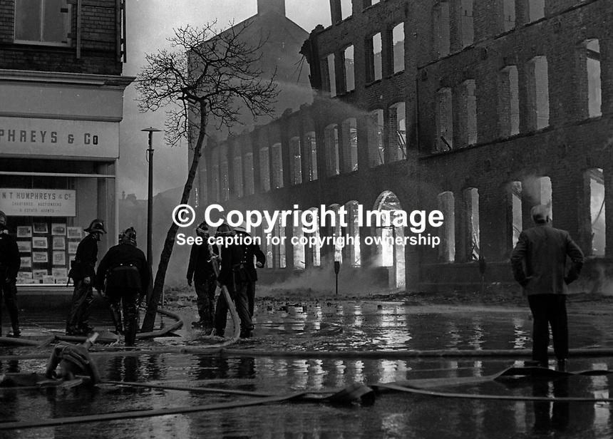 Firemen tackle blaze in Dublin Road, Belfast, N Ireland, following Provisional IRA explosions 6th December 1971. 197112060541c<br />